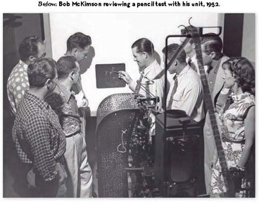 Bob McKimson reviewing a pencil test with his animation unit 1952