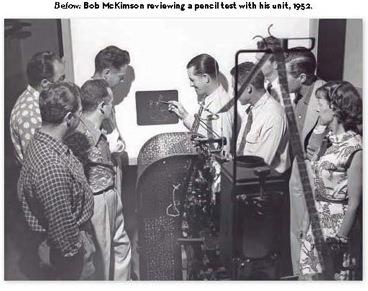 Bob McKimson reviewing a pencil test with his animation unit 1952